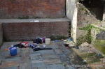 Unwashed clothes left behind at the Dhunge Dhara near Bhatbhateni Temple